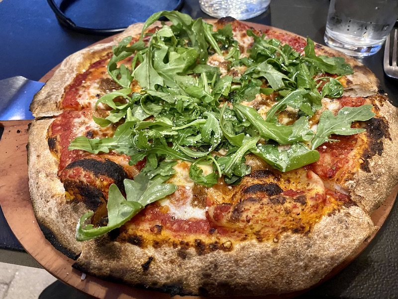 oven fired pizza with arugula